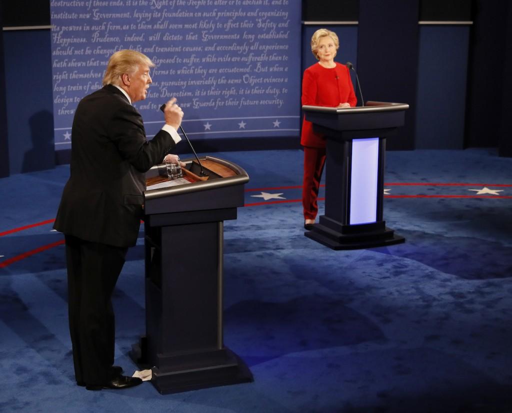 Republican presidential nominee Donald Trump gestures during the presidential debate with Democratic presidential nominee Hillary Clinton at Hofstra University in Hempstead, N.Y., Monday, Sept. 26, 2016. (Rick T. Wilking/Pool via AP) NYDB515